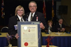 Donna Sampson & Brian Weaver, President of the Ontario Command, with the official document for Branch 643 - Photo by Jose Atencia Ocadio.